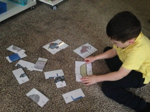 kid playing puzzle